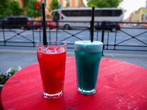 Sweet cold red and blue cocktails on the table royalty free stock image