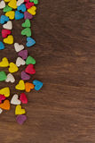 Sweet color candies on heart-shaped cakes Royalty Free Stock Photos
