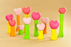 Sweet color heart on post made from plasticine Royalty Free Stock Images