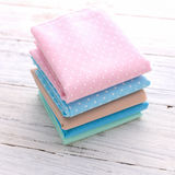 Sweet color of napkin stack on wooden Stock Images