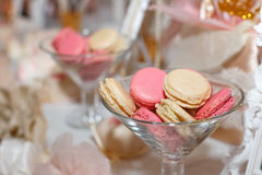 Sweet colored macaroons in glasses, on the holiday table Stock Images