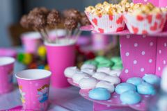 Sweet colored meringues, popcorn, custard cakes Royalty Free Stock Photography