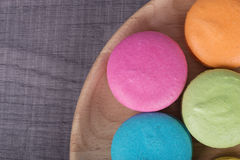 Sweet colorful cake macaron in plate on wood table Royalty Free Stock Images