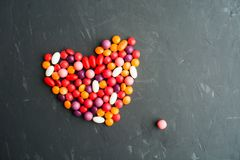 Sweet colorful candy heart over grey background. With copy space; flat lay Stock Photo