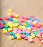 Sweet colorful candy hearts. Background Stock Photos