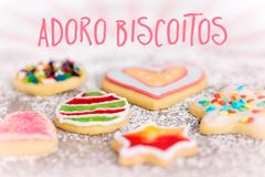 Sweet and colorful cookies on icing sugar background, spanish Te royalty free stock image