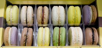 Sweet and colorful french macaroons on retro-vintage background Royalty Free Stock Photography