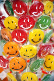 Sweet colorful laughing lollipops on street market as a backgrou Royalty Free Stock Image