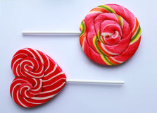 Sweet colorful lollipops. Lollipop candy. Sweet red heart Spiral Lollipop On White Background. Sweet multicolor Spiral Lollipop On White Background Stock Photos