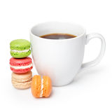 Sweet and colorful macaroons with cup of coffee on white background. Traditional french dessert macarons.  Stock Photo