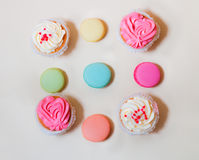 Sweet colorful macaroons and cupcakes Royalty Free Stock Photo