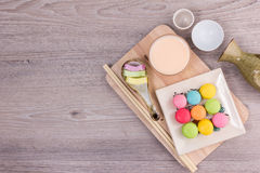 Sweet colorful macaroons on a wood background Royalty Free Stock Photos
