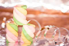 Sweet colorful marshmallows on shining background Stock Images