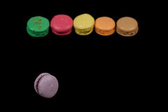 Sweet and colorfull french macaroons on black background. Sweet and colorfull french macaroons or macaron on black background stock images