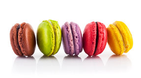 Sweet coloured macaroon dessert. Sweet coloured macaroons dessert on white background stock photography