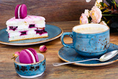 Sweet and Colourful Cake with French Macaroons with Cup of Cofee Royalty Free Stock Images