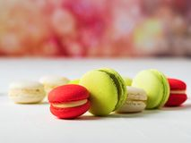 Sweet and colourful french macaroons on colorful spring background with copy space stock photos