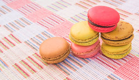 Sweet and colourful french macaroons on cotton cloth background. Royalty Free Stock Photo