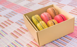 Sweet and colourful french macaroons on cotton cloth background. Royalty Free Stock Photos
