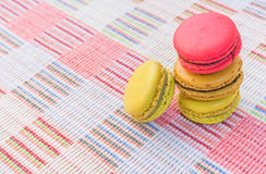 Sweet and colourful french macaroons on cotton cloth background. Stock Photo