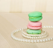Sweet and colourful french macaroons and pearls Royalty Free Stock Photos