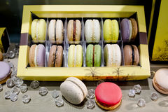 Sweet and colourful french macaroons on retro-vintage background Stock Image