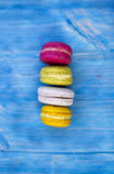 Sweet and colourful french macaroons on retro-vintage background Stock Photo