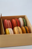 Sweet and colourful french macaroons on white backgro Stock Photos