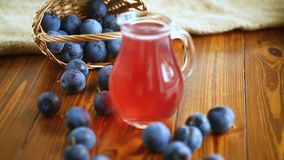 Sweet compote of autumn blue plums in a glass decanter stock video footage