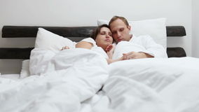 Sweet conversation in morning bed stock video footage