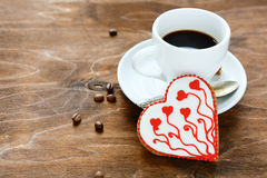 Sweet Cookie for Valentine's day with coffee on plywood Stock Photos