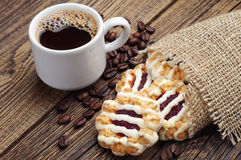 Sweet cookies and cup of coffee Stock Photos