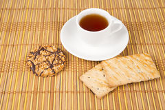 Sweet cookies  and cup of tea on the bamboo mat Stock Photo