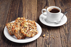 Sweet cookies with nuts and coffee Royalty Free Stock Image