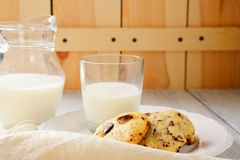 Sweet cookies on a plate with milk Stock Photography