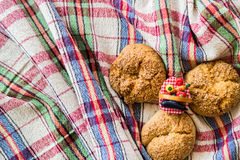 Sweet cookies on a rustic (plaid) tablecloth. Stock Photo