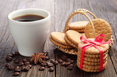Sweet cookies tied ribbon and cup of coffee Royalty Free Stock Photography