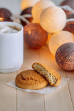Sweet cookies on wooden natural background. Near the cookie is white cup with coffee Royalty Free Stock Photography