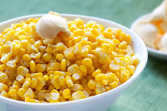 Sweet Corn. In a serving bowl, with a know of butter Stock Photos