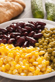 Sweet corn, beans and peas in a white plate Stock Image