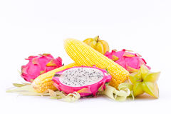 Sweet corn cobs kernels and dragon fruit pitaya and star fruit carambola  on white background  fruit and vegetable isolated Stock Photography