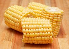 Sweet corn cobs on the wooden board Royalty Free Stock Photography