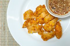 Sweet Corn Fritters,Crispy fried corn in a white plate on bamboo Stock Photo