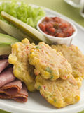 Sweet corn Fritters with Salsa Gherkins Avocado Royalty Free Stock Image