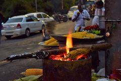 Sweet corn frying on the fire wood......... royalty free stock images
