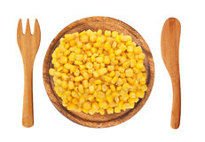 Sweet corn grain on wooden plate, fork and knife isolated Royalty Free Stock Photo
