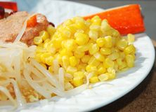 Sweet Corn kernels in Salad. Mixed Salad : mung beans sprouts and sweet corn kernels, with surimi fish sticks and tuna in background Stock Images