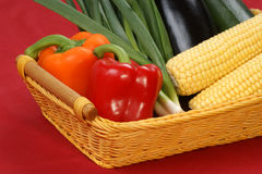 Sweet corn and pepper in a basket Royalty Free Stock Images