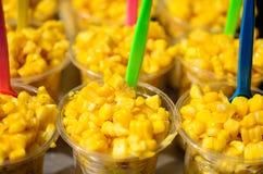 Sweet corn in plastic cap on Street Market Stock Images