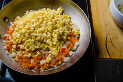 Sweet corn red peppers and onions Stock Photo